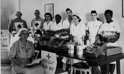 Personnel of the Red Cross Society of Sudan photographed ready for the Red Cross and St John War Organisation flag day