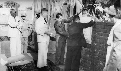 Sir Robert Howe levelling the foundation stone for the new Sudan Red Cross Headquarters in Khartoum
