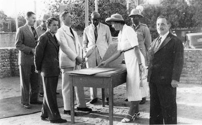 Sir Robert Howe looking at [plans for the new Sudan Red Cross Headquarters] in Sudan