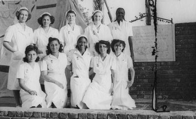Red Cross personnel posing next to the foundation stone for the headquarters of the Sudan Branch of the British Red Cross in Khartoum, Sudan