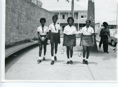Four Antigua Junior Red Cross members in uniform with collecting boxes during [Red Cross week]