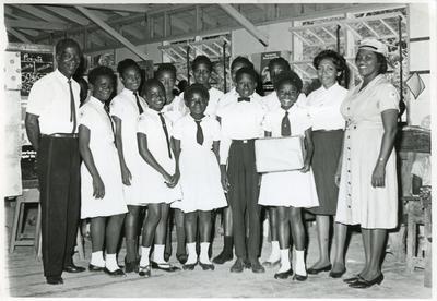 Group of Antiguan Junior Red Cross members with senior Red Cross members
