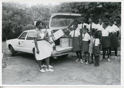 Antigua branch VAD cadets and Juniors unloading food supplies to be given to children in the community out of the City of St Johns
