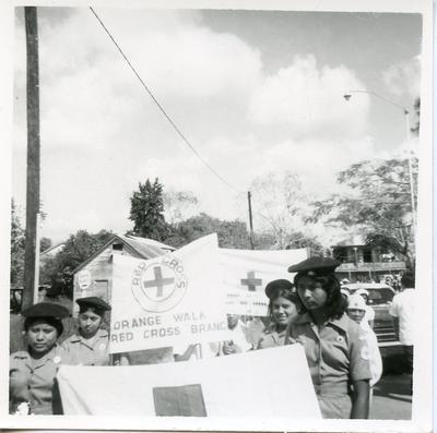 Youth members at a rally carrying banners