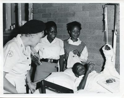 Mrs F Thomas with Juniors of the Botswana Red Cross visiting patients in hospital