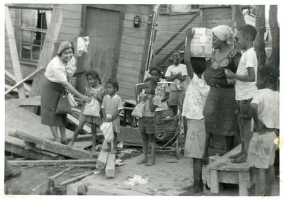 Distribution of British Junior Red Cross disaster relief kits after hurricane Hattie in British Honduras
