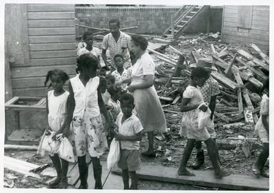 Distribution of British Junior Red Cross disaster relief kits after hurricane Hattie in British Honduras