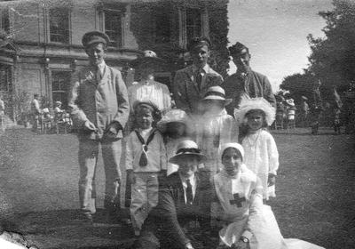 Wounded soldiers with one Red Cross nurse in uniform, four children and two women outside Red Maids Hospital, Bristol