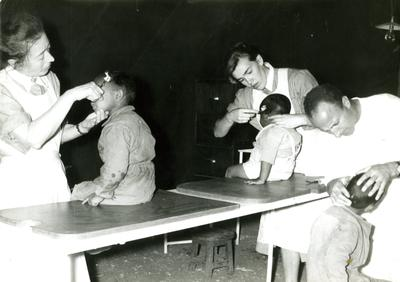 Children receiving medical care from French and Swiss Red Cross nurses following the earthquake in Agadir.