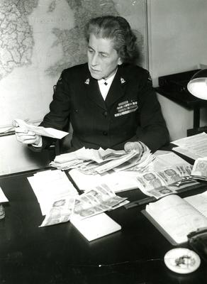 Black and white photograph. Lady Limerick going through the first batch of letters of donations for the victims of the earthquake in Agadir.