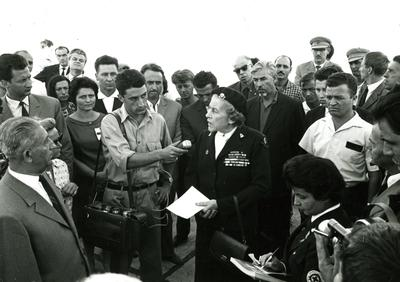Black and white photograph. Lady Limerick being welcomed in Skopje