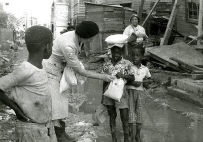 Black and white photograph. Disaster relief kits provided by the Junior Red Cross for victims of Hurricane Hattie