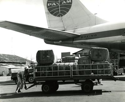 Black and white photograph. Relief supplies for victims of flooding in Vietnam