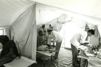 Black and white photograph. A polyclinic in a tent for victims of the conflict in Yemen.