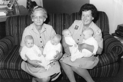 Red Cross volunteers with quad babies