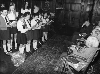 Junior Red Cross members singing carols