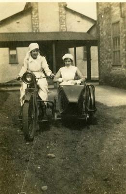 VAD Nurses on motor-bike and sidecar, Southmead, Bristol