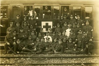 VADs, male members beside ambulance train