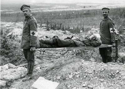 German Red Cross stetcher bearers with a British casualty