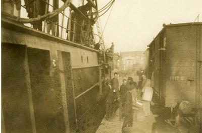 Black and white photograph of loading the British Red Cross mission stores at Salonica - Balkan War 1912-1913
