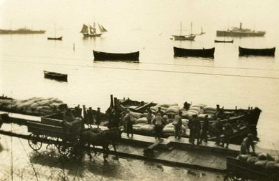 Black and white photograph of the unloading of sacks of flour for refugees in Salonica - Balkan War 1912-1913
