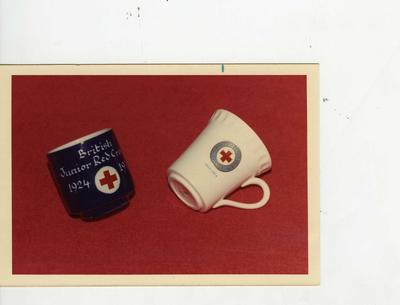 Colour photograph of British Red Cross mugs commemorating 1924-1974