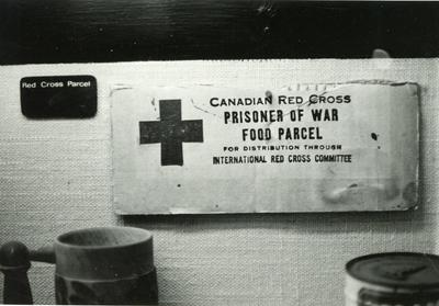 Black and white photograph of an archive item on display at Barnett Hill