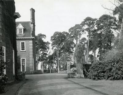 Black and white photograph of the gardens and exterior at Barnett Hill