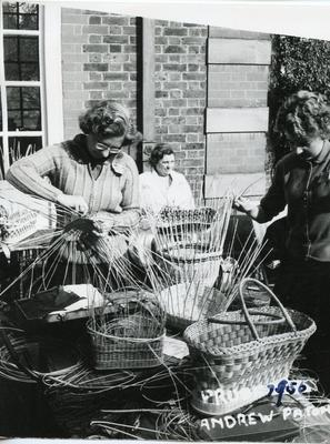 Black and white photograph of basket weaving activity at Barnett Hill