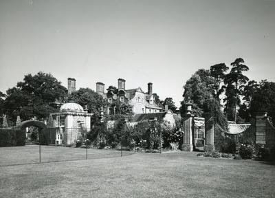 Black and white photograph of the gardens and exterior of Barnett Hill