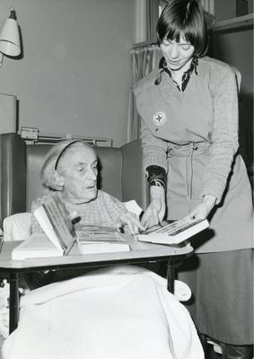 Black and white photograph used in Red Cross News of Felicity Ambrose and the Hospital Library service