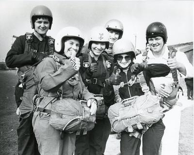 Black and white photograph used in Red Cross News of volunteers from Merseyside branch about to do a parachute jump