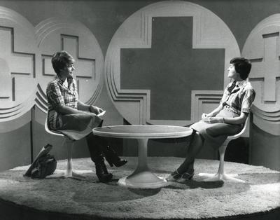 Black and white photograph of Judith Chalmers and Denise Barnett filming 'Home Nursing' for Tyne Tees Television