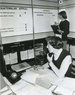 Black and white photograph from Red Cross News June 1976 of the Disasters Emergency Committee Operations Room set up to help victims of the Guatemalan earthquake