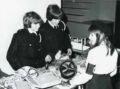 Black and white photograph from Red Cross News June 1976 of cadets from the Hertfordshire branch at a jumble sale