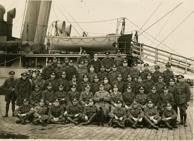 British Red Cross Society Male Detachment in front of a hospital ship[?]
