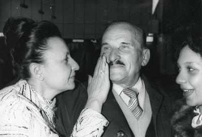 Black and white photograph from Red Cross News 1980s of the reunion of Nina Holland and her father after 40 years