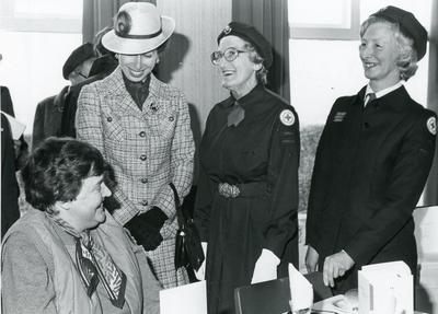 Black and white photograph from Red Cross News of Princess Anne meeting Lesley Ransay and Jennie Pidgeon from Swanage March 1984