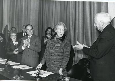 Black and white photograph of Angela Countess of Limerick receiving the Henry Dunant Medal at the Palais des Nations in Geneva