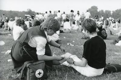 Black and white photograph of First Aid treatment at Knebworth Festival