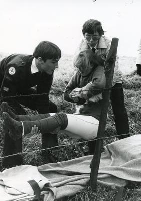 Black and white photograph of First Aid in action