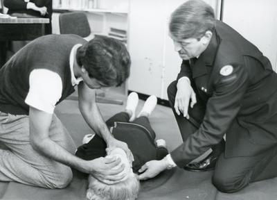 Black and white photograph of First Aid training