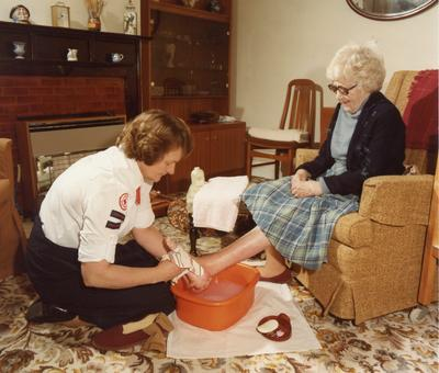 Colour photograph of nursing in the home