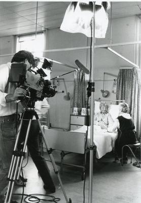 Black and white photograph of filming by London Weekend Televsion of a film requesting volunteers for the Beauty Care service