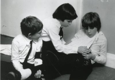 Black and white photograph of Red Cross Youth members learning first aid