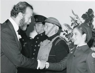 Black and white photograph of the Duke of Kent meeting a Red Cross cadet
