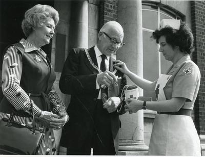 Black and white photograph of collecting during Red Cross Week 1976