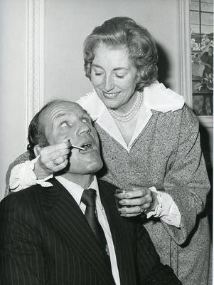 Black and white photograph of Dame Vera Lynn and Henry Cooper promoting Nursing for the Family