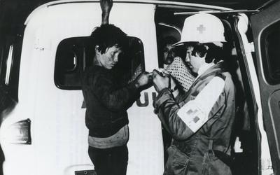 Black and white photograph for World Red Cross Day 1979 - Night-time medical patrol operated by Colombian Red Cross Youth volunteers