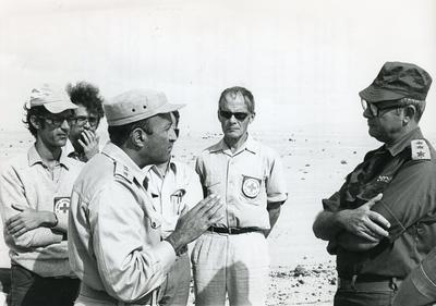 Black and white photograph for World Red Cross Day 1977 of an Egyptian and Israeli officer meeting in no-man's land in 1973